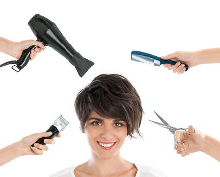Happy smiling young woman with hairdresser tools among her isolated on white background Stock Photo