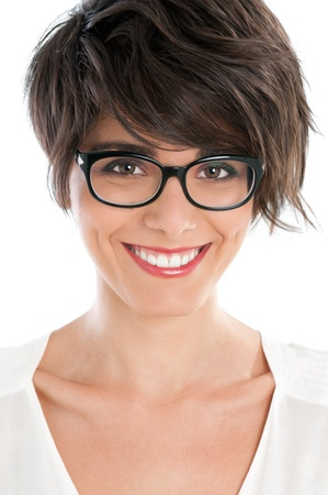 Beautiful young woman smiling with her new pair of eyeglasses isolated on white background photo