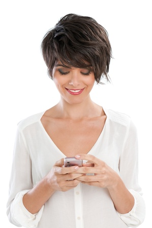 surfing the internet: Happy beautiful young woman text messaging and surfing the net with her smart phone isolated on white background