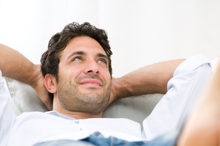 Serene happy man relaxing on sofa at home Stock Photo - 11742935
