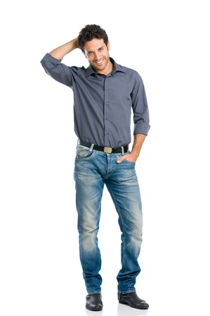 Stylish happy young man looking at camera with embarrassment isolated on white background photo