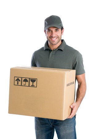 mover: Smiling young delivery man holding and carrying a cardbox isolated on white background Stock Photo