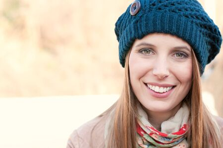 Smiling beutiful lady looking at camera outdoor in winter time photo