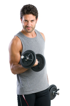 weightlifting equipment: Satisfied young strength man lifting dumbbell isolated on white background