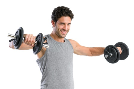 Happy smiling young man lifting weight isolated on white background photo