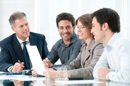 Happy smiling business team working together at office Stock Photo - 12155610