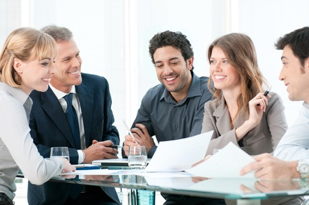 discuss: Business people discussing and working together during a meeting in office Stock Photo