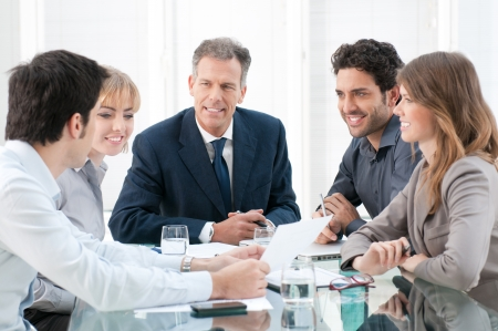 discuss: Business group of people discussing and working together at office Stock Photo