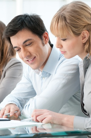 Business executives working together with dedication at office Stock Photo - 12155622