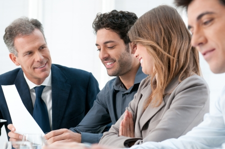 dedication: Business people discussing and working together during a meeting in office Stock Photo