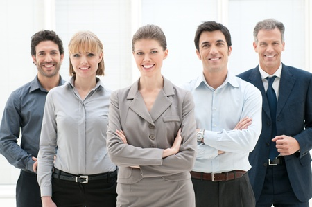 job satisfaction: Happy smiling group of business people standing together at office