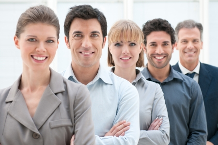 satisfied people: Happy smiling business team standing in a row at office Stock Photo