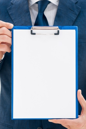 check up: Business man in suit holding a blank clipboard ready for your text or image