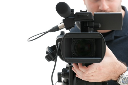 camera operator: Video camera operator working with his professional equipment isolated on white background
