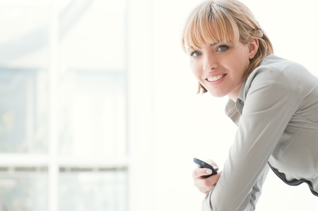 Beautiful business woman smiling and looking at camera in a modern office photo