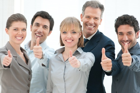 thumbs up woman: Happy business people cheering and showing thumb up at office