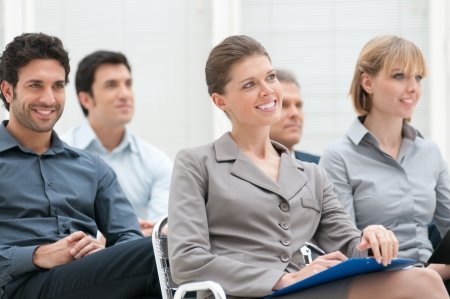 attend: Happy business group attending an educational meeting conference Stock Photo