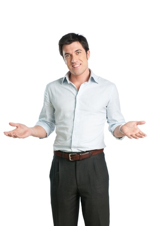 Satisfied smiling man with arm outstretched looking at camera photo
