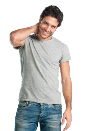 Young casual hispanic man looking at camera with satisfaction  photo