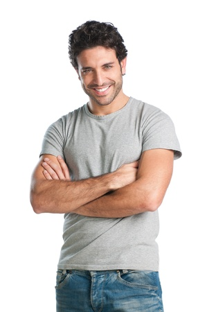 Casual young man looking at camera with arms crossed and satisfaction photo