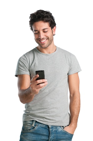 man phone: Smiling young man looking at his smart phone while text messaging isolated on white background