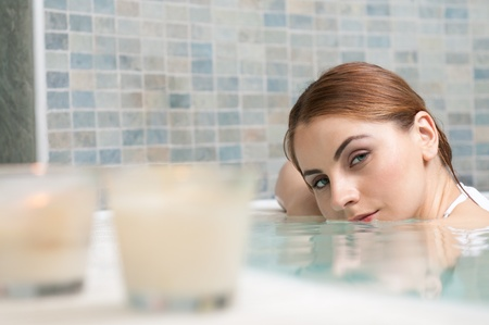 Beautiful young woman relaxing in a jacuzzi at thermal spa club Stock Photo - 13741842