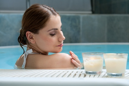 Beautiful young lady realxing at thermal bath in a beauty center Stock Photo - 13741858