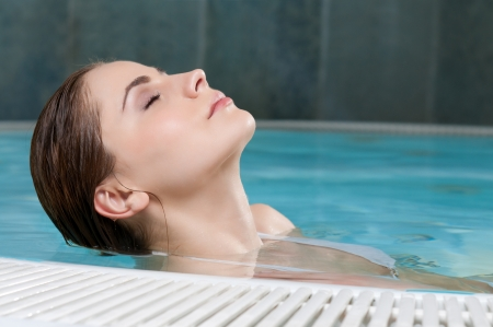 Beautiful young lady relaxing at thermal bath in a beauty center Stock Photo - 13741851