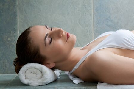 Happy smiling young lady relaxing in a turkish bath at spa center Stock Photo - 13741932