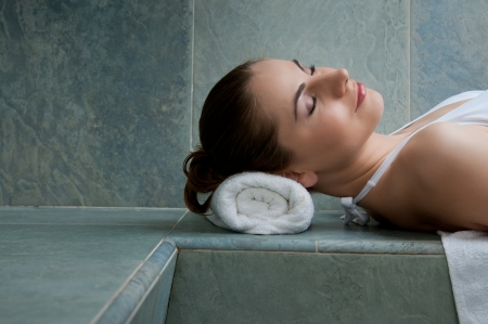 young girl bath: Beautiful young lady relaxing in a turkish bath at spa club