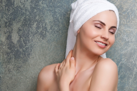 Beauty portrait of young woman with towel on head at spa Stock Photo - 13741950