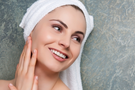 Beautiful young woman smiling and relaxing at spa center photo