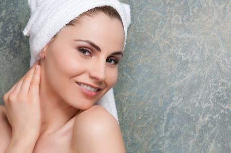 Beautiful young lady with towel smiling at spa Stock Photo - 13741936