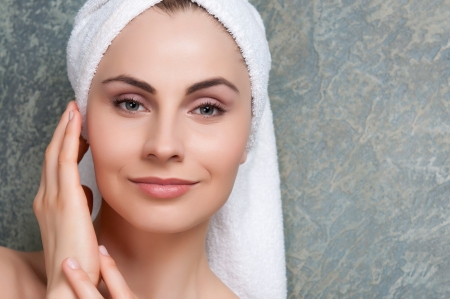 Beauty portrait of young woman with towel on head at spa Stock Photo - 13741850