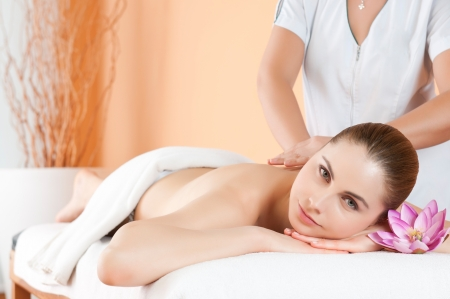 Beautiful young woman receiving hand massage on her back at beauty spa salon Stock Photo - 13741839