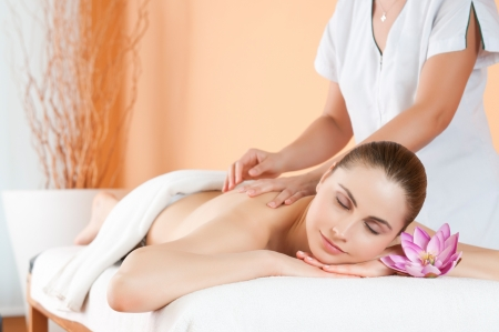 Beautiful young girl relaxing with hand massage at spa during a beauty treatment Stock Photo - 13741840