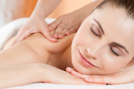 Relaxing massage at beauty spa salon photo