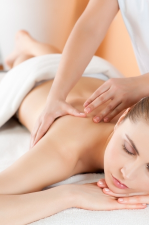 Beautiful young girl relaxing with hand massage at spa during a beauty treatment Stock Photo - 13741841