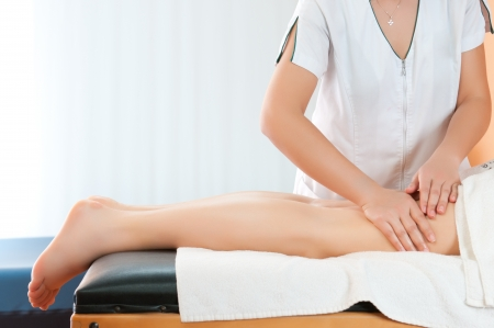 Legs massage to reduce cellulite and preserve an healthy look Stock Photo - 13741837