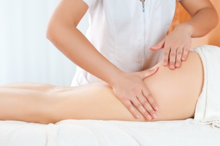 Legs and buttocks massage to reduce cellulite and preserve an healthy look photo