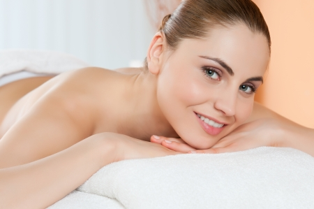 Beautiful young girl relaxing and smiling at camera at spa club Stock Photo - 14272877