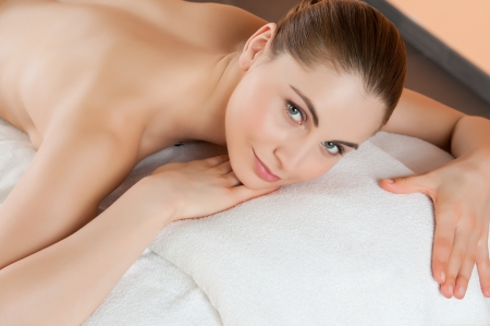 Beautiful young girl lying and relaxing at health spa club Stock Photo - 14272924
