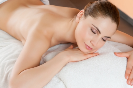 Beautiful young woman relaxing and lying at health spa club Stock Photo - 14272925