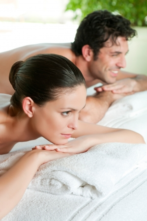 Beautiful young couple enjoy together a beauty treatment at spa  photo