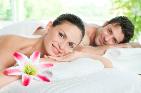 Happy smiling couple enjoy a beauty treatment photo