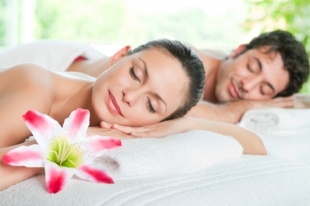 Beauty woman and man relaxing together during a spa treatment photo