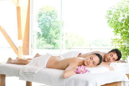 Beautiful relaxed couple enjoy the peace after a beauty treatment photo