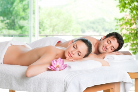 Beautiful couple relaxing together at spa centre after a beauty treatment photo