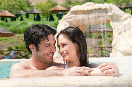 Happy young couple enjoy together the summer at resort pool photo