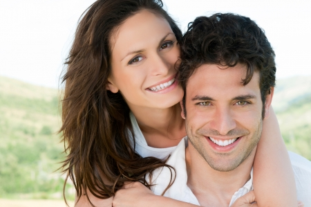 Happy smiling couple enjoy together the summer outdoor photo